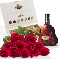 Roses, Cognac and chocolates, photo is illustrative